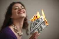 salesperson burning money